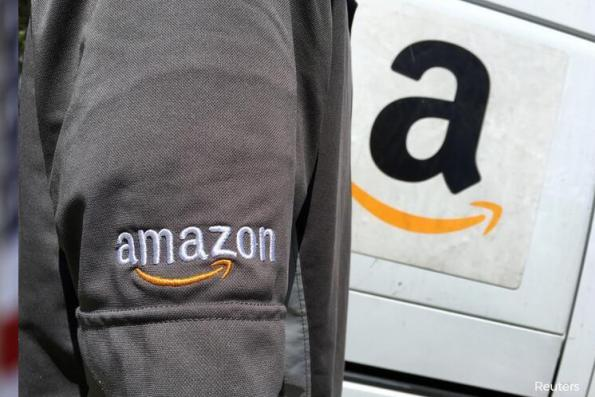 Amazon plans to split 2nd headquarters in two cities — sources
