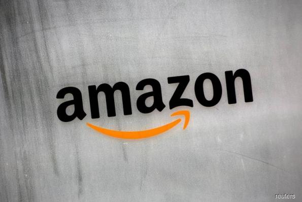 Amazon beats estimates, Wall St breathes sigh of relief