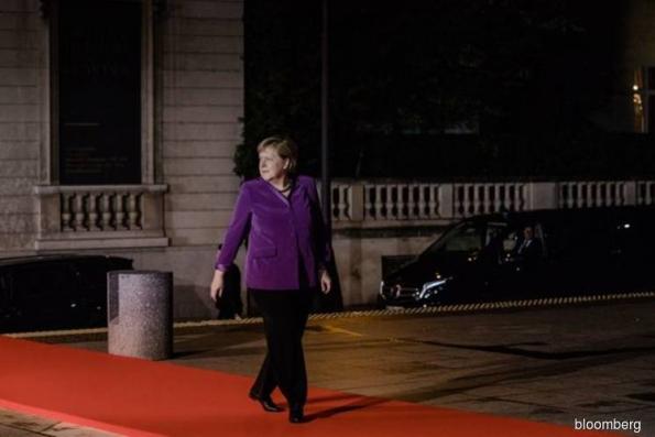 Merkel bid to make Germany Inc a world champion hits EU snags