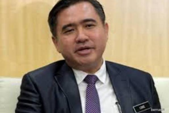 Putrajaya caps e-hailing commission and fare surcharges
