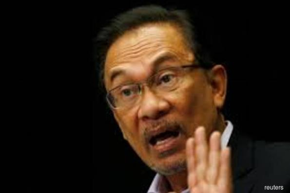 Anwar's party doesn't expect him to be Malaysia's PM just yet