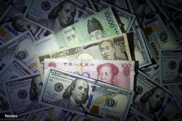 Most Asian currencies trade flat, oil slump backs importers' currencies