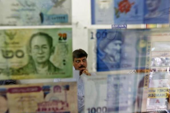 Most Asian currencies weaken as global equities battered