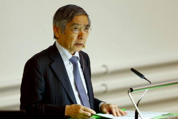 BOJ chief signals chance of rate hikes, warns of risks of easing