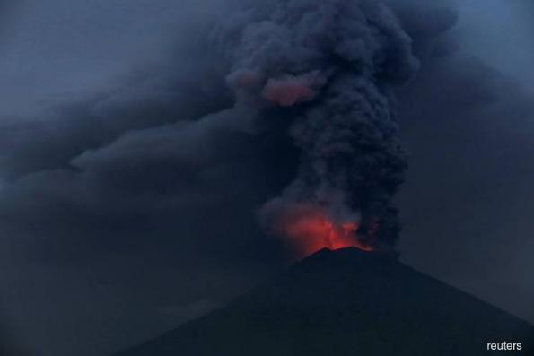 Bali volcano eruption halts some flights
