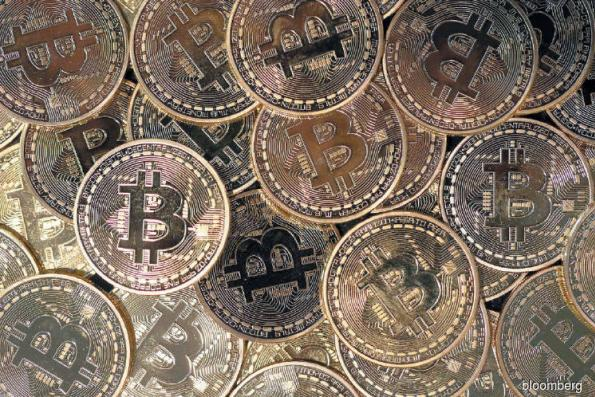 Bitcoin prices 'bubble-like' after record rally: BlackRock