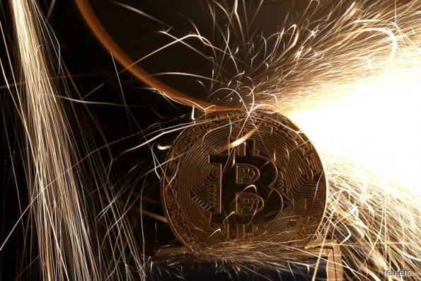 Bitcoin Tumbles Most in Three Months Amid South Korea Hack