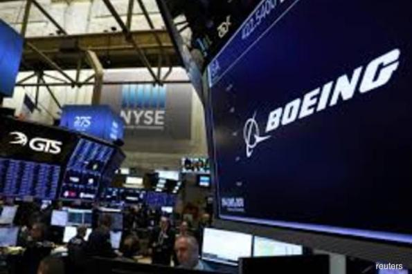 Boeing shares take another hit as more countries ground 737 MAX 8 planes