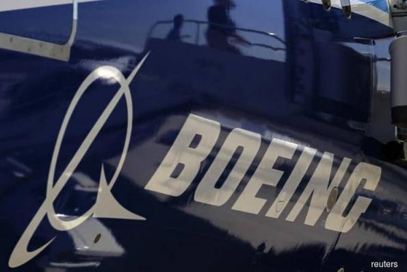 Boeing lifts industry demand forecast as air show deals roll on