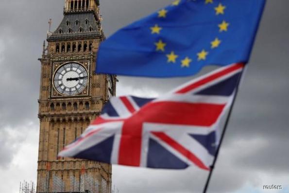 Britain and EU reach deal to move Brexit talks forward