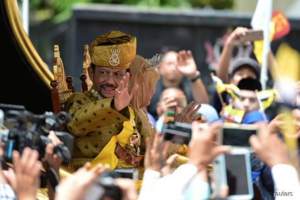 Your gilded chariot awaits: Brunei sultan celebrates 50 years in power