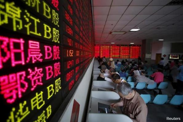 China shares end higher as slowing GDP adds to stimulus hopes