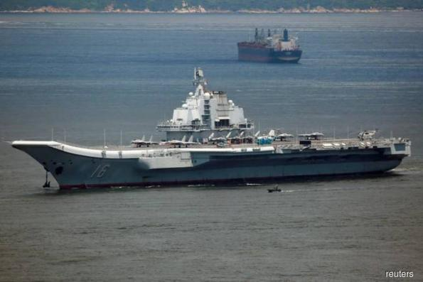 Amid tension, China carrier group sails through Taiwan Strait