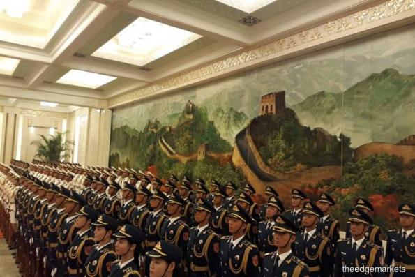 China rolling out red carpet for Tun M at Great Hall of the People