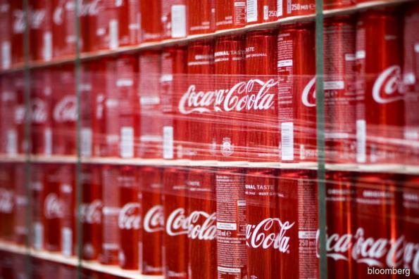 Coke drops most since 2008 as pressure rises amid tough outlook