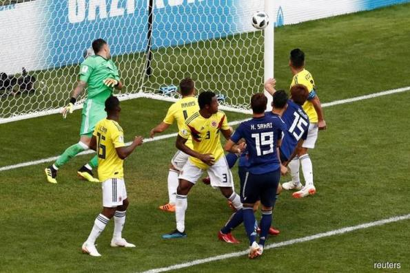 Japan sink 10-man Colombia in historic win for Asia
