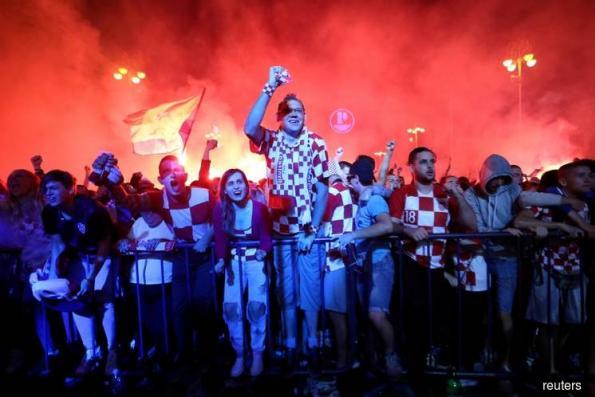 Jubilant Croatia fans revel in World Cup semi-final win over England