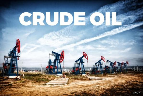 Oil prices edge up on falling US crude inventories, but global glut still weighs