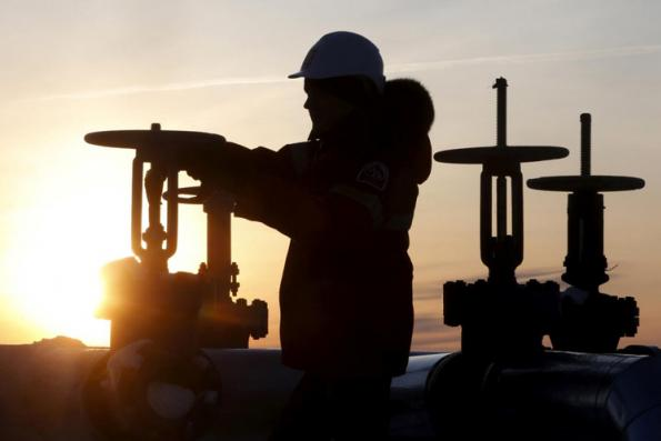 Oil slips after US output hits a new record, stocks rise