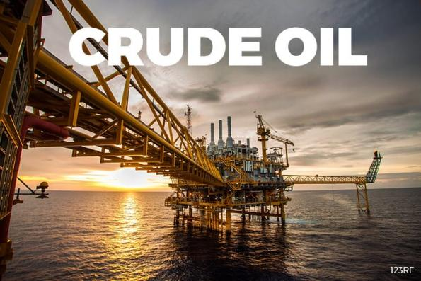 Oil edges up on falling US crude stocks, but global glut weighs