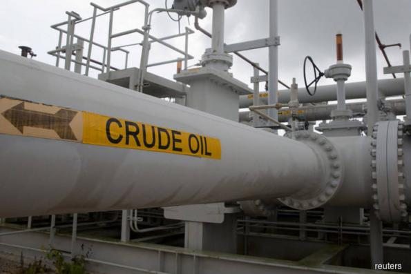 Brent crude oil dips on rising OPEC output; looming sanctions on Iran prevent bigger fall