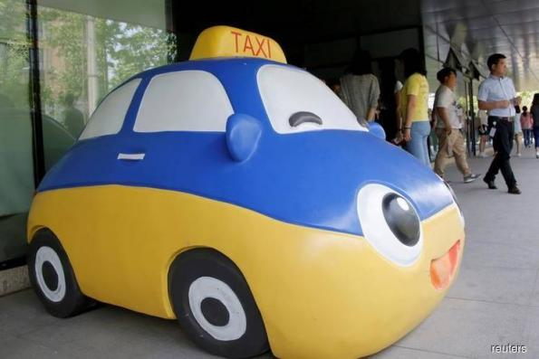 China's Didi Chuxing buys control of Brazil's 99 ride-hailing app