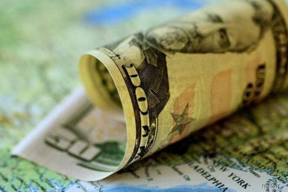 Dollar slides as risk appetite improves