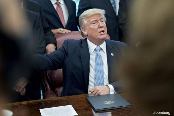 JPMorgan Says Trump May Sell Dollars as Weapon in U.S. Trade War