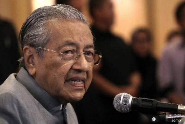 Dr M to bring in Chinese car parts makers to improve local talent