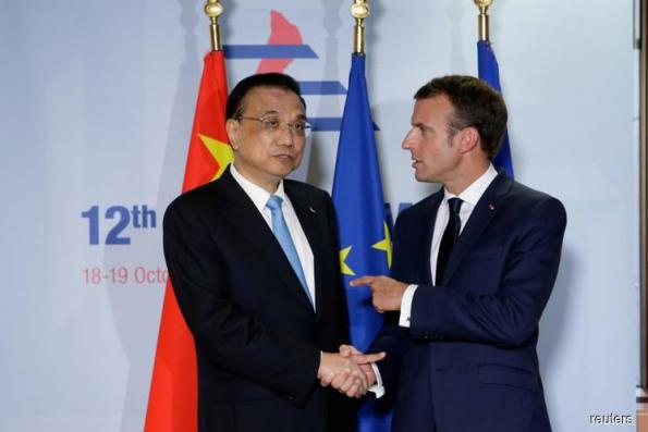 EU cultivates Asian leaders on trade, climate in message to Trump