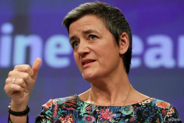 EU's top regulator under fire over Italy bank rescue decision