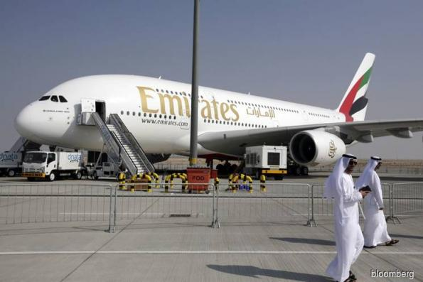 Emirates warns of tough six months ahead as profit drops