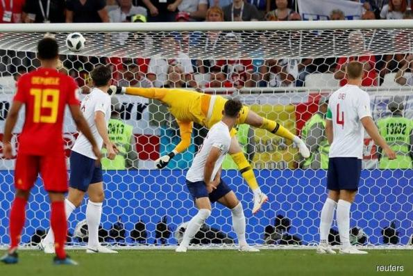Belgium beat England to top spot with Januzaj strike