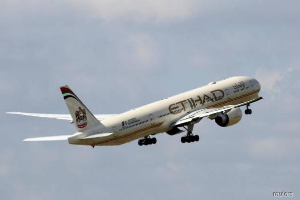 Abu Dhabi's Etihad reorganises in drive to return to profit