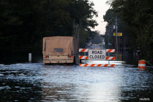 Carolinas deluged by floods as Florence moves on