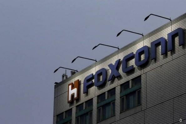 Foxconn profit below forecast on soaring operating costs, shares fall