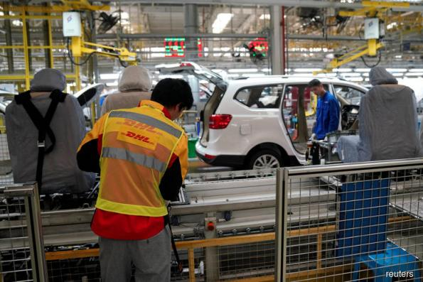 GM, DHL use a Chinese plant to lead manufacturing change