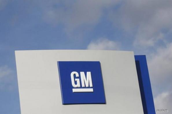 Trump tariffs bite into GM 2018 profit forecast, stock falls
