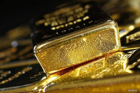 Gold eases on firm dollar but heads for first weekly gain in four
