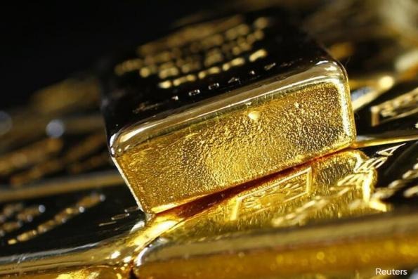 Gold at 2-wk high as cloudy US rate hike outlook drags on dollar