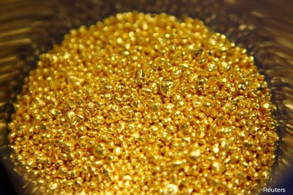 Gold scales two-week high as US dollar slides