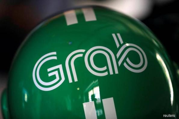 Hyundai Motor invests in ride-hailing firm Grab