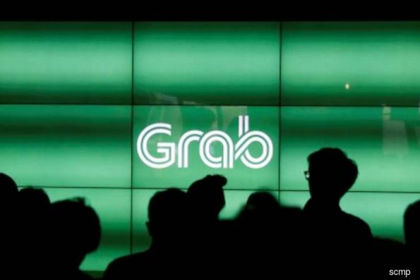 Grab vanquishes Uber with local strategy, billions from SoftBank