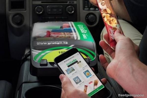 Grab commuters can now shop and collect freebies with a new in-car service, Grab&Go