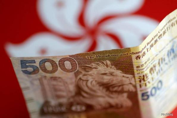 Hong Kong spends US$1.2b defending currency overnight