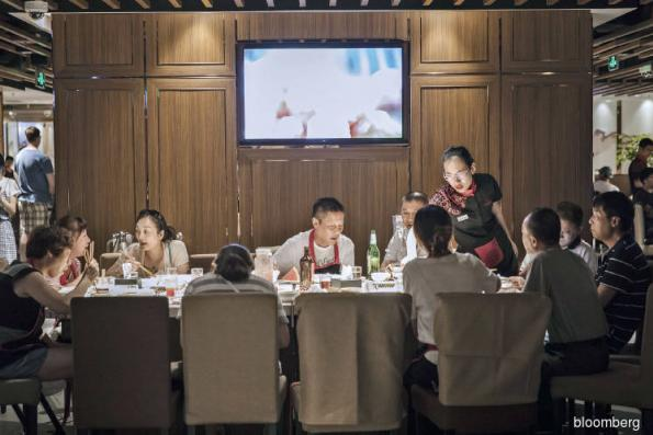 Food: China's spicy hotpot billionaire to take on world