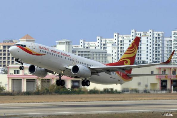 Singapore Inc buys an overpriced ticket to Hainan
