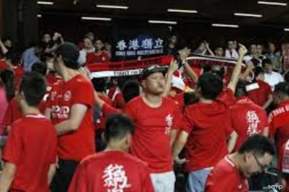Soccer: Hong Kong gets AFC warning after fans jeer China anthem