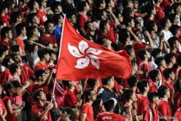 Hong Kong moves to make disrespecting Chinese anthem a crime