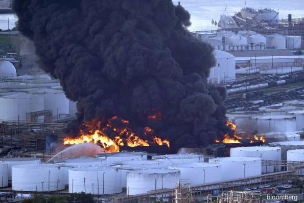 Chemical fire darkening Houston flares as smoky odor spreads